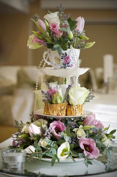 Wedding table centerpiece - the shabby chic tower, not the floral arrangement.