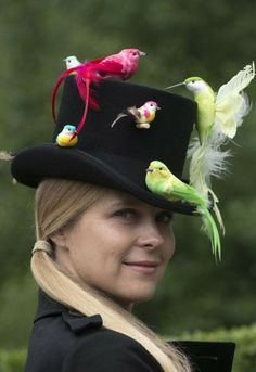 Amber Tolchard chose a traditional tophat with an embellishment of colourful birds