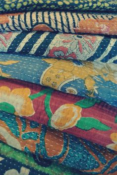 Vintage handmade Kantha quilts from India.