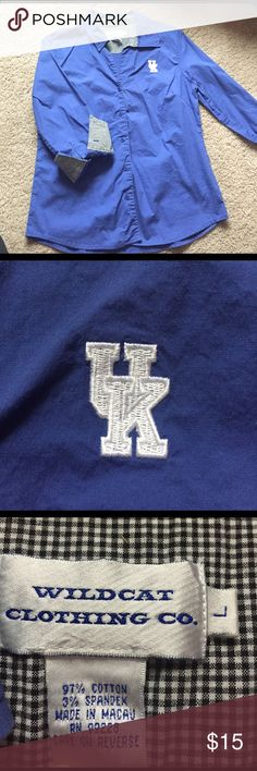 Women's UK button down top Given as a gift, it's just not my style top. Worn two times during March Madness games. UK logo is in great condition!! Kentucky blue with black and white checkered pattern at each cuff (if you want to wear the cuffs rolled up). 3/4 length sleeves. Tapered women's fit through the waist. One small stain under the first button. Not noticeable though when on as it's on the underside of where the bust is (at least on me). Feel free to ask any questions! Tops Button…
