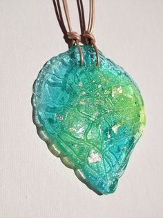 SALE 30% OFF Aqua Blue Green Resin Leaf Pendant on Leather on Etsy, $18.00 AUD