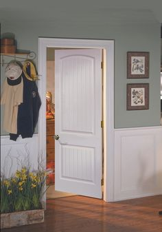 THESE ARE THE INTERIOR DOORS I WANT FOR MY FUTURE HOME!  White, two-panel, arched interior doors!