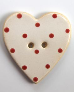 Handmade ceramic button - white heart with red dots