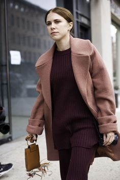 Dusty rose-colored winter coat perfectly styled with a berry ribbed knit matching set | Street Style from New York Fashion Week Fall 2016 @stylecaster