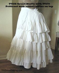 Grand Bustle This bustle is perfect for 1869 to 1875 styles! Add ruffles over each bone and at the bottom and you have your first petticoat layer attached. ;-)