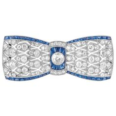 Art Deco Platinum, Diamond and Sapphire Bow Brooch, France  One old-mine cut diamond ap. .40 ct., 14 old-mine & 56 single-cut diamonds ap. 1.85 cts., with French assay marks, c. 1920, ap. 7 dwt.