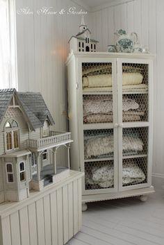 Chicken wire cabinet.