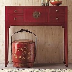 bit more traditional piece. Console table in sleek red lacquer. Great piece for entry or hall to store keys and other little bits that we always misplacing.