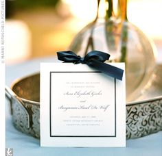 Even with its contemporary square shape and romantic satin bow, the wedding program reflected a sophisticated aesthetic rooted in tradition. The formal, cursive script in the couple's names made a striking contrast to the modern typeset used elsewhere.