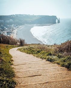 Just a little but more from the charming #Etretat in #France.  If we would have to name one place that we enjoyed the most in this little resort town, it would be this particular spot on the way to the top of Falaise d'Aval cliff.  Twisty path on the edge of such a spectacular cliff, and the view that could totally capture you for hours.  Seems like a perfect place for watching #sun going, doesn't it? ☺☺ #TravelersChild #LoveTheWorld #IAmATraveler #BeautifulDestinations #GetOlympus…
