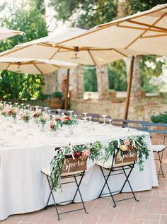 "At a Tuscan or rustic chic Italian themed wedding, chair signs with ""sposa"" and ""sposo"" take the place of ""bride"" and ""groom"" ~ http://www.stylemepretty.com/2015/09/29/tuscany-outdoor-spring-wedding/"