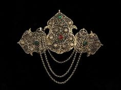 Woman's buckle, late-Ottoman, from Cyprus, ca. Silver-gilt filigree with silver-gilt sheet edging, set with red and green pastes. Antique Jewelry, Gold Jewelry, Jewellery, Greek Traditional Dress, Folk Clothing, Turkish Fashion, Folk Embroidery, Victoria And Albert Museum, Filigree