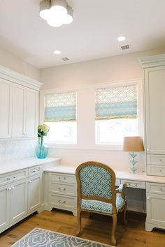 Cottage laundry room features pale green cabinets painted Benjamin Moore Hollingsworth Green paired with white countertops and a blue mosaic tiled backsplash illuminated by a Basil Flush Mount.