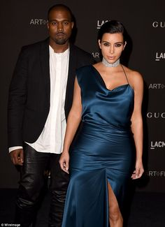 His favourite look: Kanye was clad in black leather trousers and a matching suit jacket with a white shirt and brown suede boots