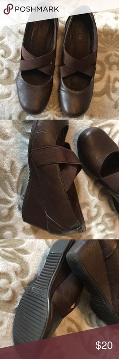 Docker's slip on. Dark brown slip ons wedge by Dockers. Very comfortable with low heel. Used but still in good condition only left side insole towards toes is coming off. But can be fixed. Dockers Shoes Wedges