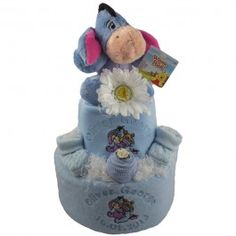 This gorgeous personalised 2 tier nappy cake for a baby boy features our most popular character - Disney's Baby Eeyore. Piled high with official Disney products and practical nursery items, it's a baby shower or newborn gift in baby blue and will make your heart melt!
