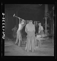 Topeka, Kansas. In the blacksmith shop of the Atchison, Topeka, and Santa Fe Railroad. In addition to the making of the railroad equipment, the blacksmith shop is used for making important repairs to the shop machinery. Here a piston is being hammered out for a drop hammer in another part of the building. LOC.