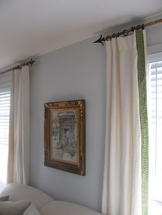 Trim on the leading edge of drapes really dresses up out of the box curtains.