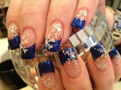 Electric blue glitter polish with freehand snowflake nail art
