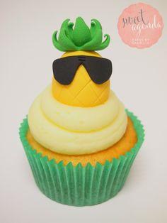 Fondant pineapple cupcake topper wearing aviator glasses by Sweet Agenda Cakes