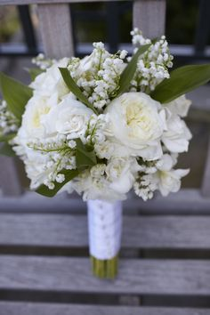 Garden Rose & Lily of the Valley White & Green Wedding Bouquet with Baby's Breath. Design and Planning by Simply Wed.   www.simplywed.com