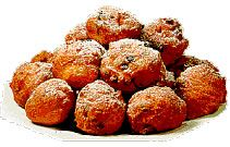 Oliebollen are a tradition on New Year's Eve in the Netherlands.  http://en.wikipedia.org/wiki/Oliebol