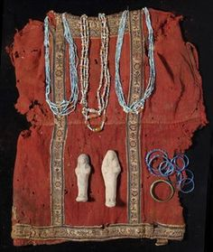 CIRCA 6TH-7TH CENTURY A.D. With red ground, decorative neck band, sleeve bands, clavi and hem with sylized floral designs, 24 in. (61 cm.) high