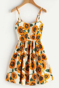 Love this bright sunflower cami dress with crisscross back and an A-line skirt. Perfect for summer days, parties and bbqs. #sunflowers #summer #ad #dresses