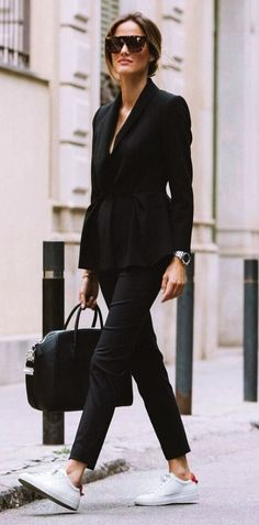 Cute-Winter-Outfits-with-white-Sneakers. all black peplum women's pant suit with brow bar oversized sunglasses