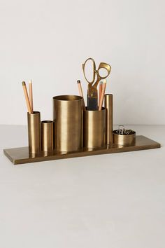 incentive for arriving at the office decor, codifi, office accessories, desk accessories, diy desk, anthropologie, brass, desk organization, pencil holders