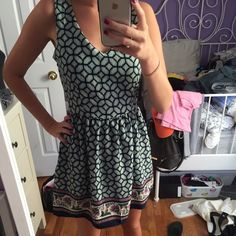 Size small summer dress! Very cute pattern. Worn once. Size small. Has a zipper down the side. Can be worn in the summer or fall. one clothing Dresses