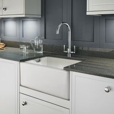 Take inspiration from kitchens of the past with a classic Belfast sink, paired with the soft curve of a swan neck nap and grey mirror chip quartz worktops. Belfast Sink Kitchen Taps, Sink Taps, Sinks, Quartz Sink, Kitchen Sink Accessories, Stone Kitchen, Industrial, Layout, Diy Bathroom Remodel