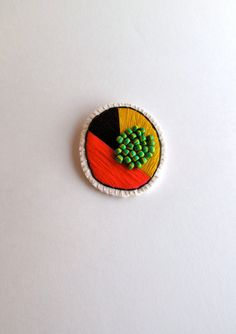Round geometric brooch hand embroidered in by AnAstridEndeavor, $35.00