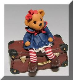 Miniature bear on a suitcase by Manda Theart..
