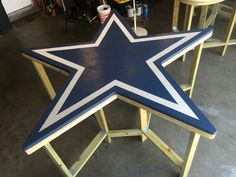"""Dallas Cowboys table for sale. $950, top is 2 layers of cedar, on 3/4"""" treated plywood, underside of exterior is lined with 2""""x4"""" treated wood as well as the legs/ supports. Table is approximately 80"""" across and 43"""" tall. Darryl.campbell@nov.com"""