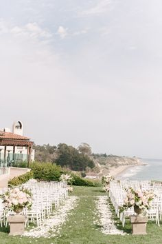 Beautiful floral arrangements and petals make this ceremony intimate with a stunning view