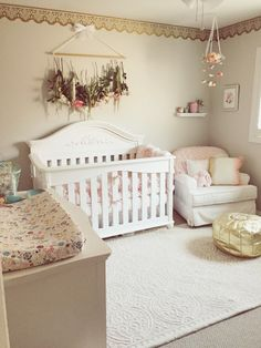 If I knew I was having a girl, I love how feminine this nursery is!