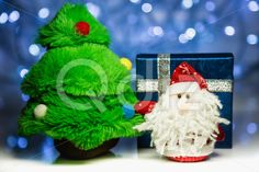 Qdiz Stock Photos | Santa Claus or Father Frost with fir tree and gift box,  #background #beard #box #celebration #Christmas #Claus #Clause #closeup #decoration #decorative #doll #eve #Father #figure #fir #frost #fun #funny #gift #greeting #holiday #light #little #Merry #new #object #package #present #red #Santa #small #surprise #toy #traditional #tree #white #x-mas #xmas #year