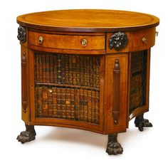 An unusual Regency parcel ebonized inlaid mahogany library table early 19th century with alterations