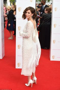 Turn around: Anna Friel's vintage style dress featured some statement back detail with the...