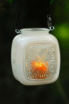 Vintage glass light cover repurposed into hanging candle holder