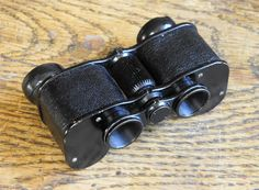 """Ross London """"Deatron"""".3X13 Opera Prism Binoculars. Serial number 29347. Year 1910. The same body were 15 years later the carrier of a 6X Ross """"Vest Pocket"""" binocular. In the 20's small binoculars was very popular for various use, motor race, boating, horse races. These two very small binoculars one for the Opera and one for the Races, don't display as luxery items. But prism binoculars never was cheap."""