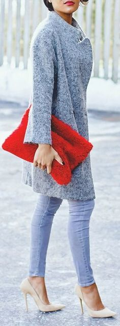 A long light blue cardigan with faded skinnies and a bright red pop of color make this perfect before--and classic street wear that will never go out of style