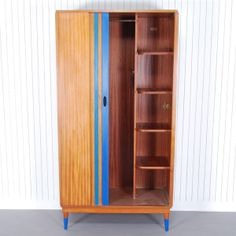 Clarke-£350.00-Clarke is a classic mid-century design. The splash of colour highlights details that are traditional in pieces made in this era, such as the shutter door and tapered legs. Clarke houses a hanging rail as well as series of shelves, provided excellent storage in a striking wardrobe.Product specification:W 92 x D 57 x H 114 cm20kg