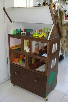Old chest of drawers repurposed into dollhouse with lift up roof; dresser re-do, perfect for little girls or boys bedroom; Upcycle, Recycle, Salvage, diy, thrift, flea, repurpose! For vintage ideas and goods shop at Estate ReSale & ReDesign, Bonita Springs, FL