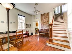 Camel Back Shotgun House (inside) With Brick Texture, Hardwood Floors And  High Ceilings