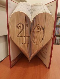 http://bookfoldingart.co.uk/product/40-heart-combi-book-folding-pattern/