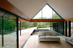 Use frameless panels of shaped structural glass to fill gable ends for a dramatic feature window