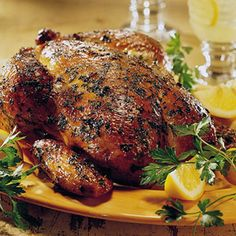 This whole roasted chicken recipe is seasoned with lemon juice, garlic, and parsley before smoke cooking.