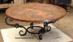 "ROUND COPPER CENTER TABLE: 47"" round copper top; ESTELA hand-forged iron table base."
